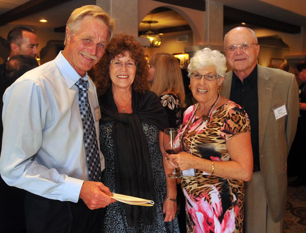 Dan & Vicki Neesby with H.E.L.P. Board Treasurer, Laura Kauls and her husband, Juris.