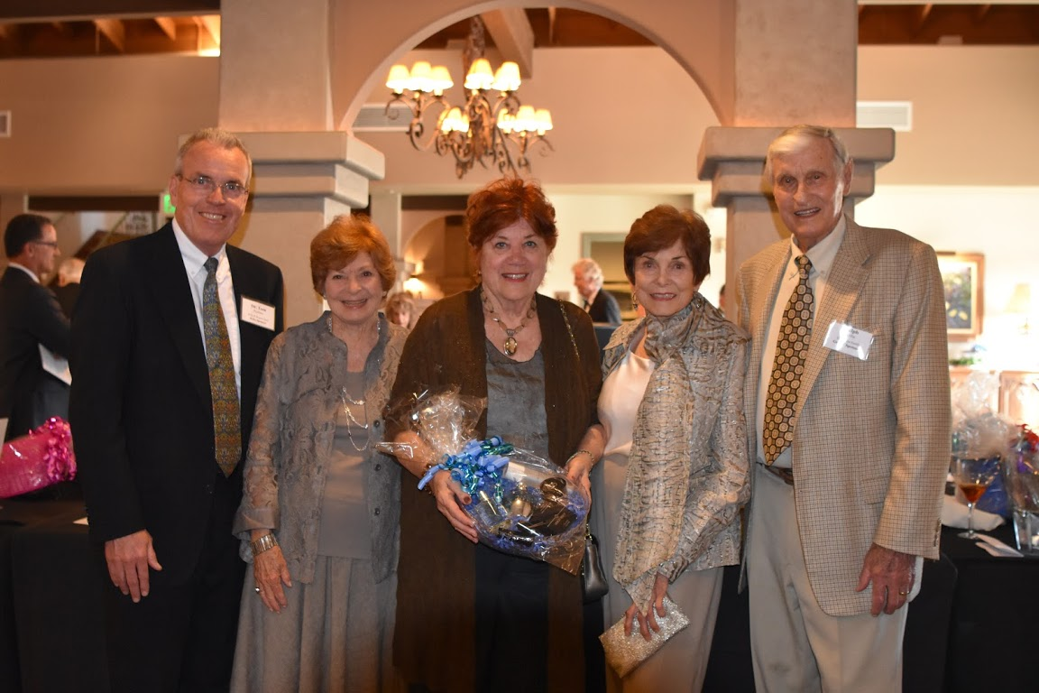 H.E.L.P. Board Chair, Tom Paulsen, (left), and Grand Sponsor, Ralph Scriba, (right), welcome gala honorees: Sherry May, Sharon Ryan, and Sharon Guthrie.