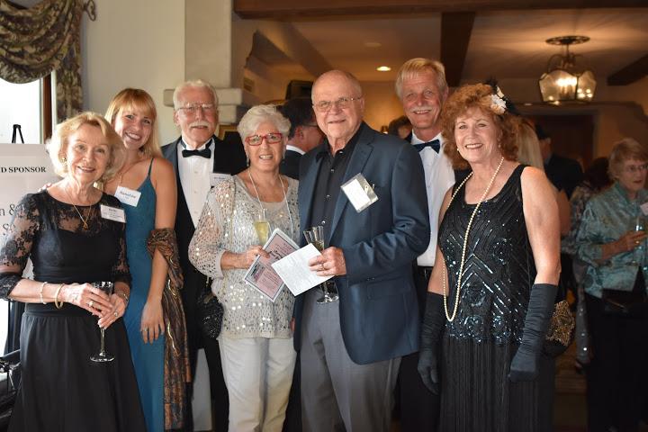 Laura Kauls, center, H.E.L.P. Board Treasurer, with Britt, Hana, and Ken Huff; Juris Kauls, and Dan & Vicki Neesby.