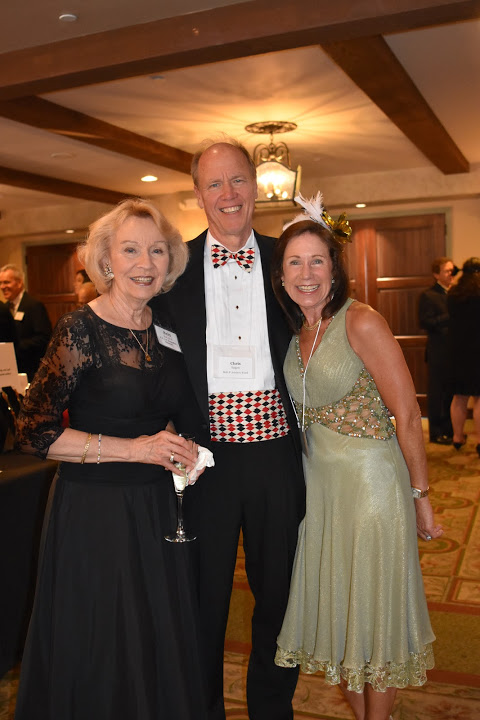 Britt Huff with Chris and Kim Engen, H.E.L.P. Advisory Board members and Décor Chair on Gala Committee.